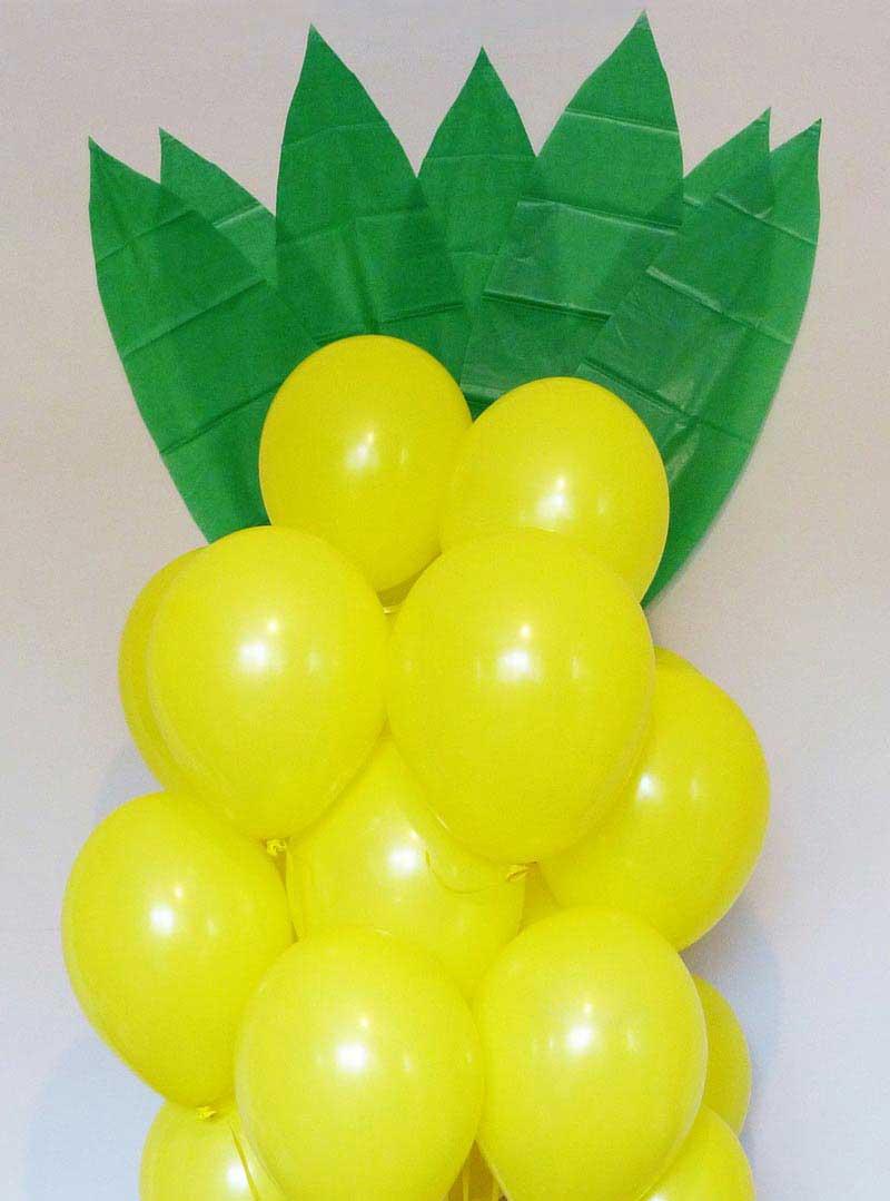 Cómo hacer una piña gigante con globos